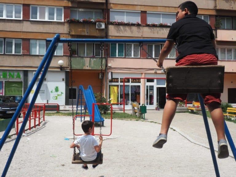 Children on swings in a playground.