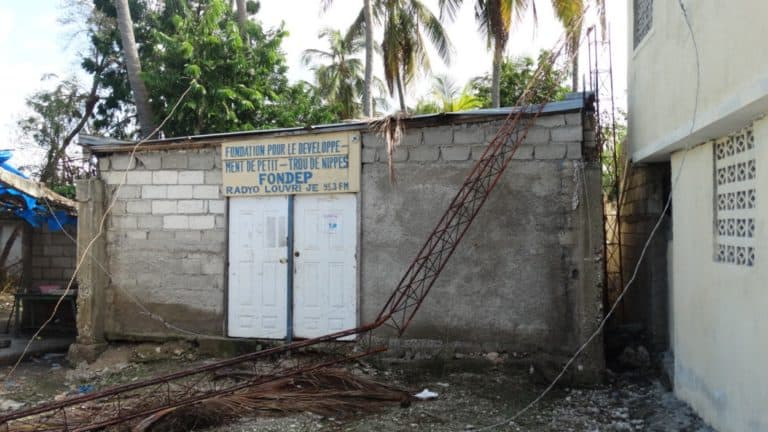 A small concrete radio station dmaged by a hurricane.