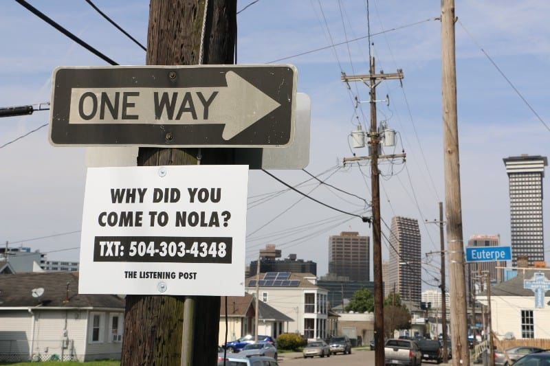 A sign posted on a telephone pole says,
