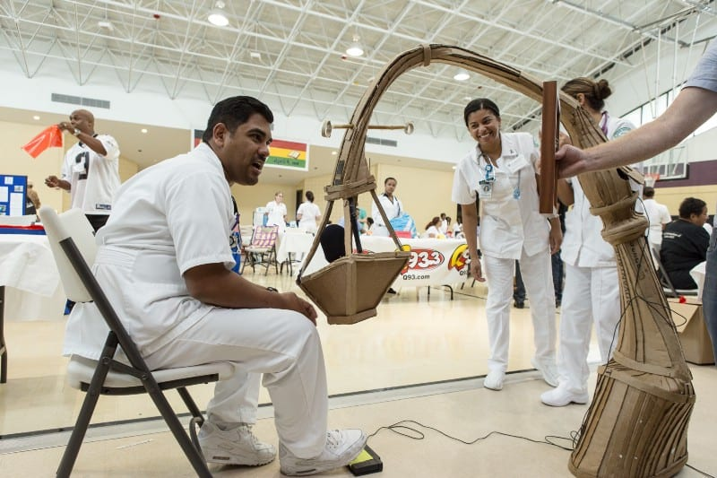 At a health fair, a health worker sits in front of a mic hidden in a basket