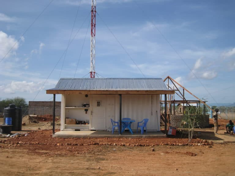 Small building with a radio tower.