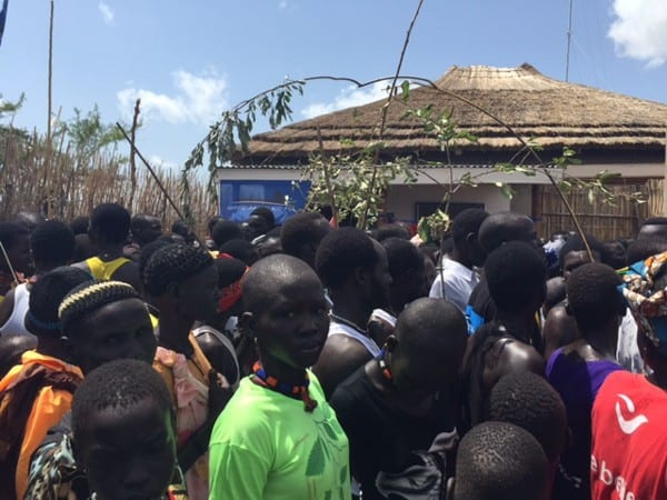 People gather outside of a rural radio station