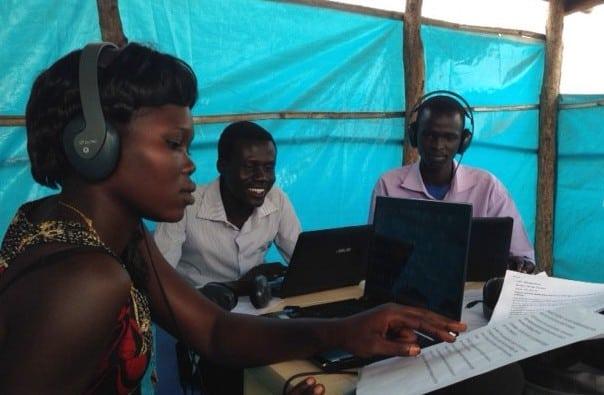 Team members work in the radio studio