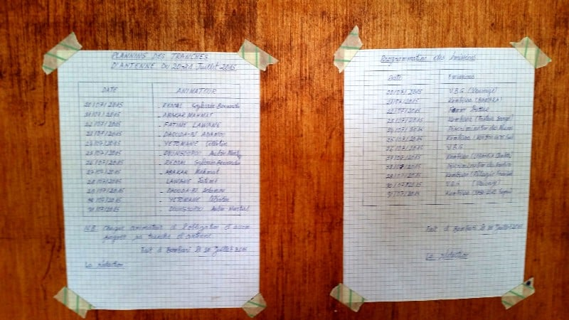 Two programs taped to the wall