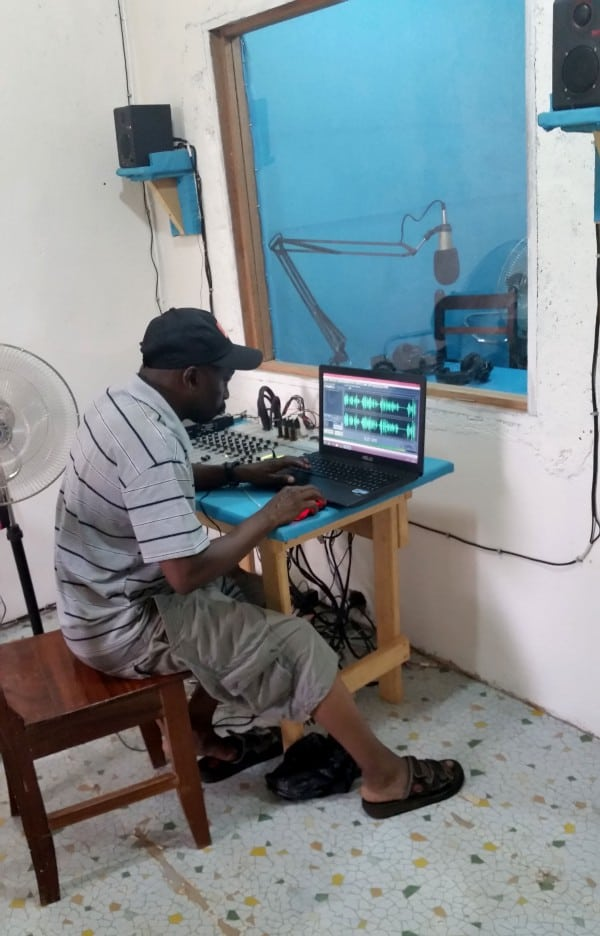 A man works on a laptop computer