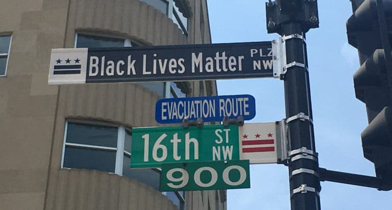 Street signs in DC - Black Lives Matter Plaza and 16th Street NW