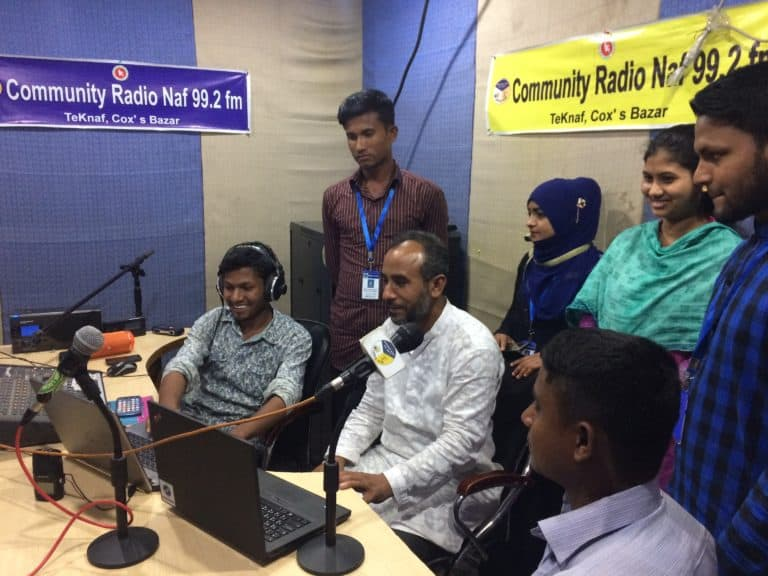 A group of people in a radio studio.