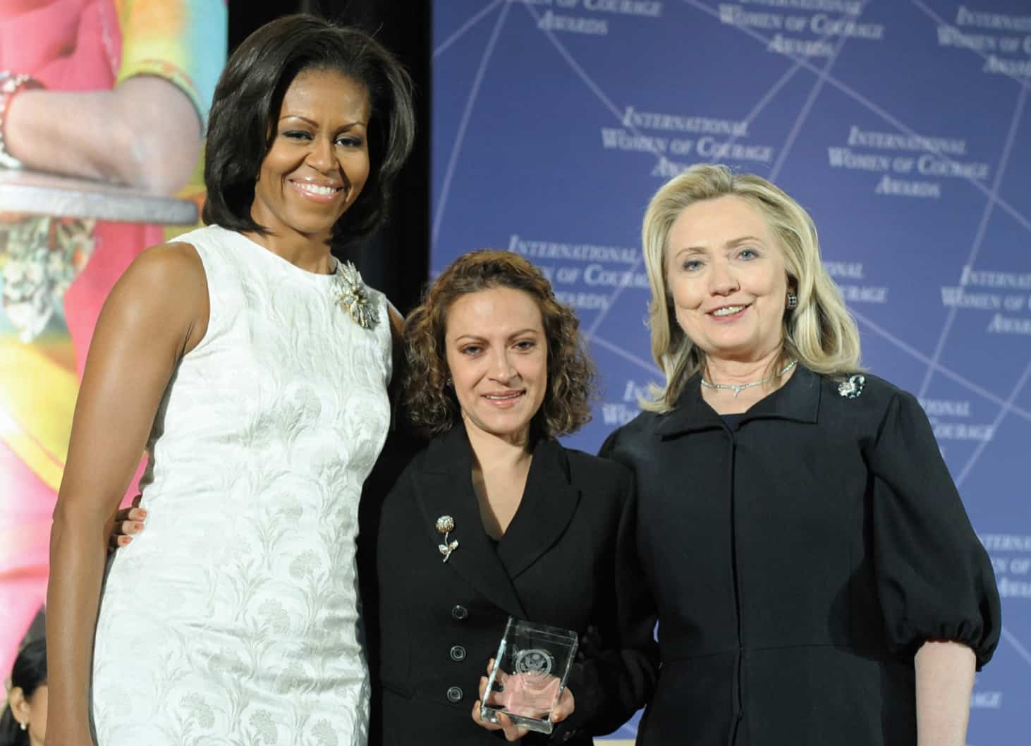 First Lady Michelle Obama, left; and Hillary Rodham Clinton, right; and pose for a photo with 2012 International Women of Courage (IWOC) Award Winner Jineth Bedoya Lima of Colombia