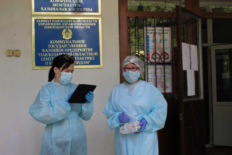 Two women in full PPE.