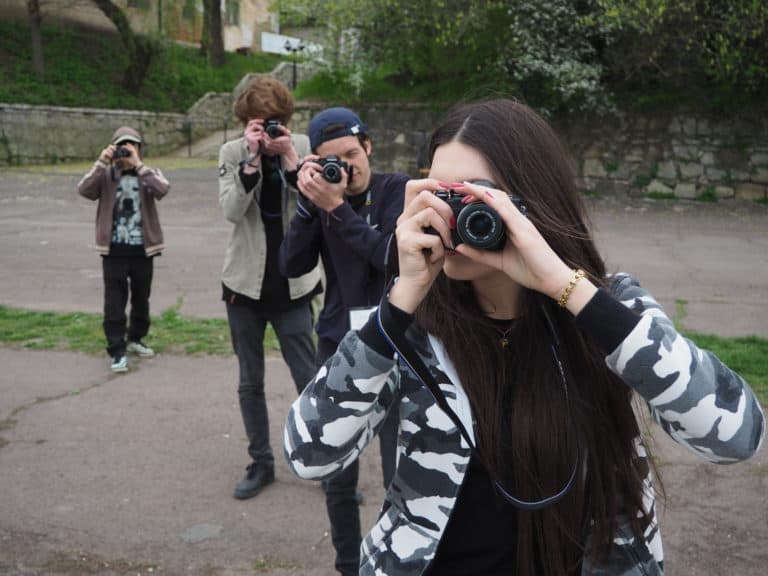 Young people using cameras.