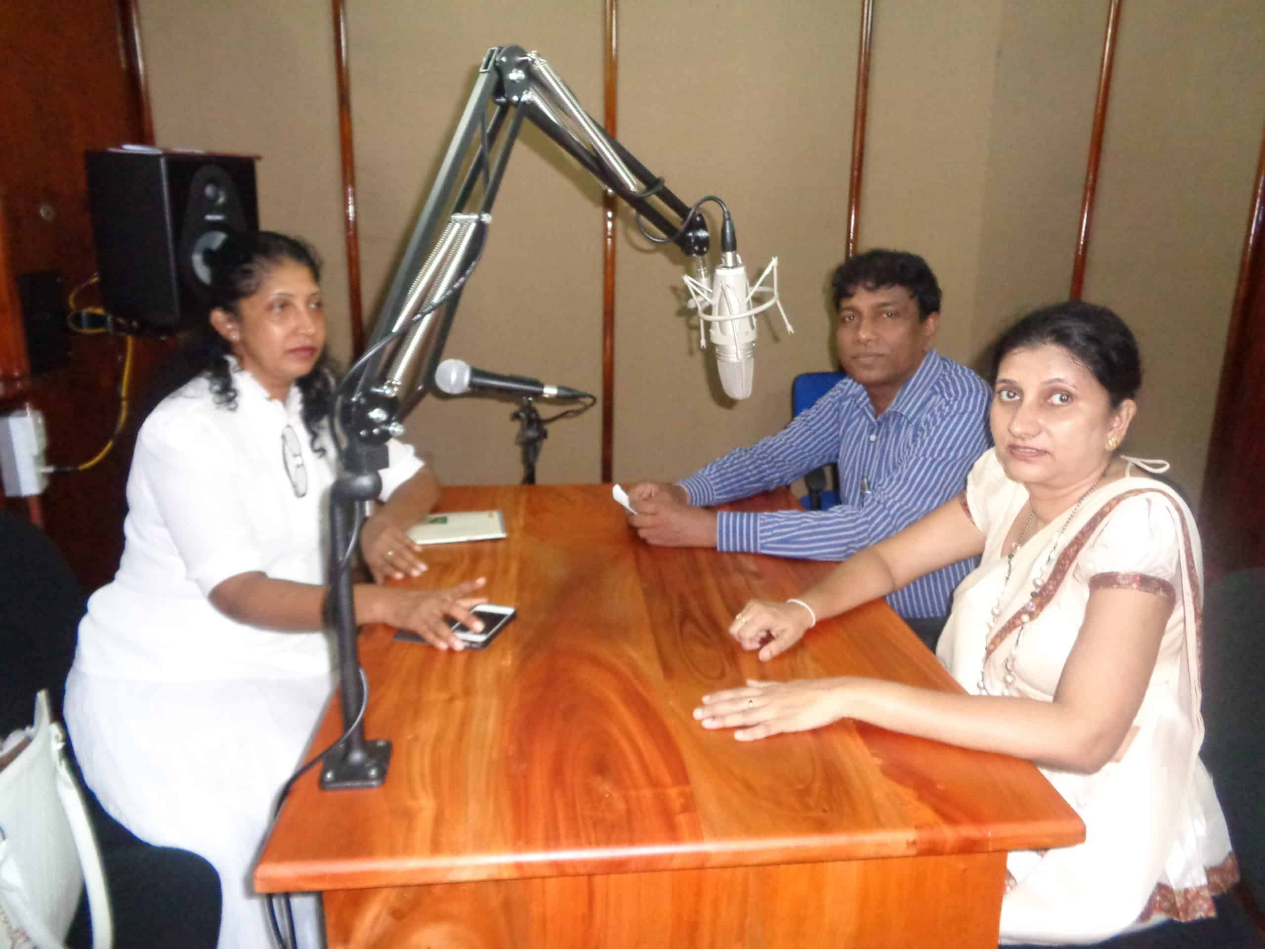 Manique and two other women in a radio studio