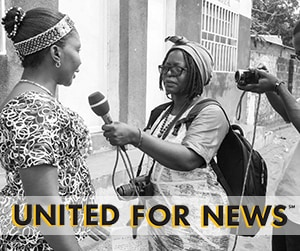 One woman holds a mic up to another woman - United for News
