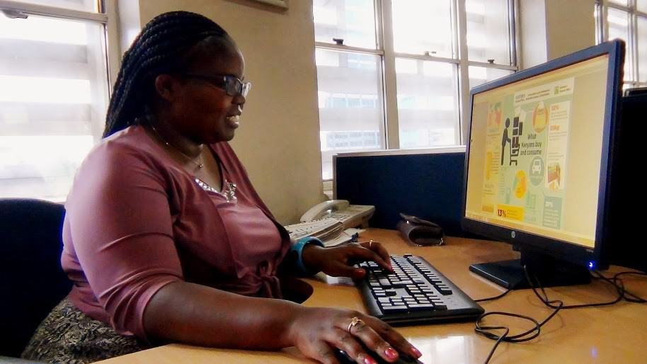 A woman works at a computer