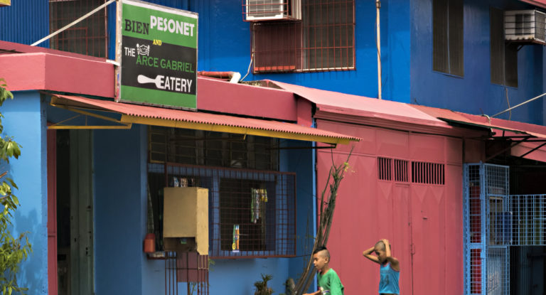 Two boys walk by a store - Bien Pesonet, The Arce Gabriel Eatery.