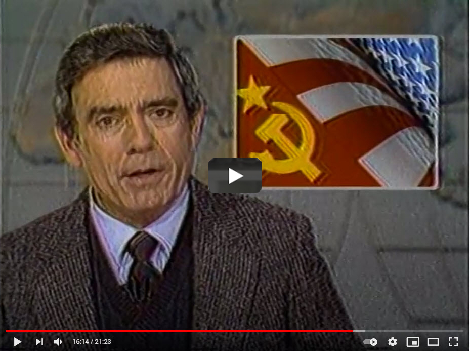 Screenshot of video - Dan Rather with inset of flags
