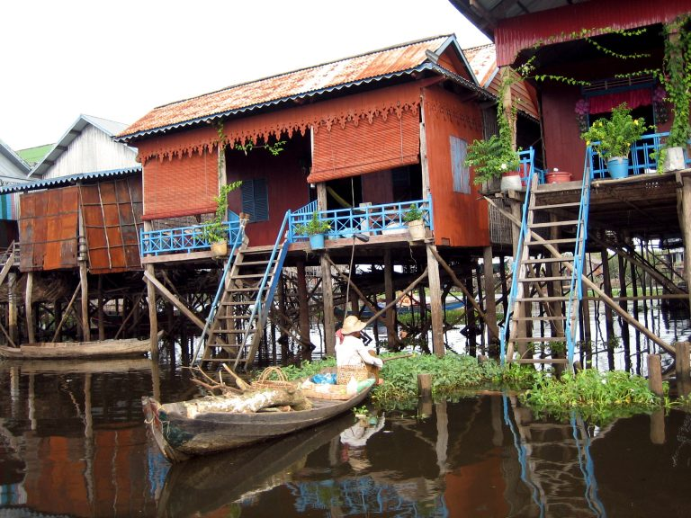 A wood house on stilts in a river
