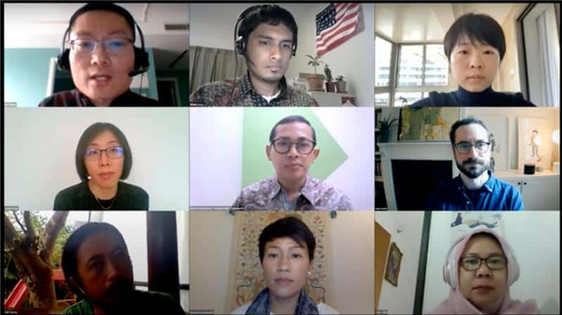 Screenshot of several faces on a zoom meeting