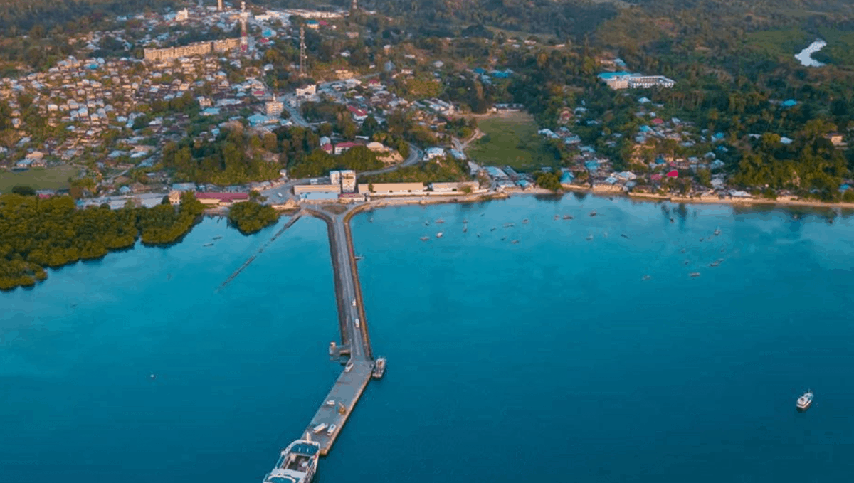 A pier extends out into a body of water