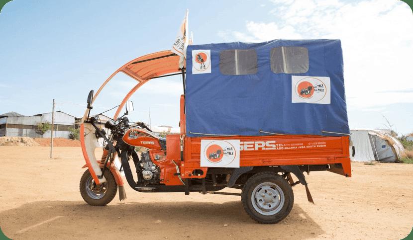 Boda Boda - a three wheeled vehicle painted orange and blue