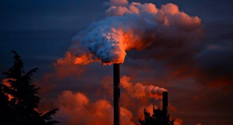 Smoke billows out of chimneys
