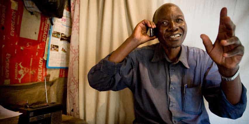 A man talks on a smart phone