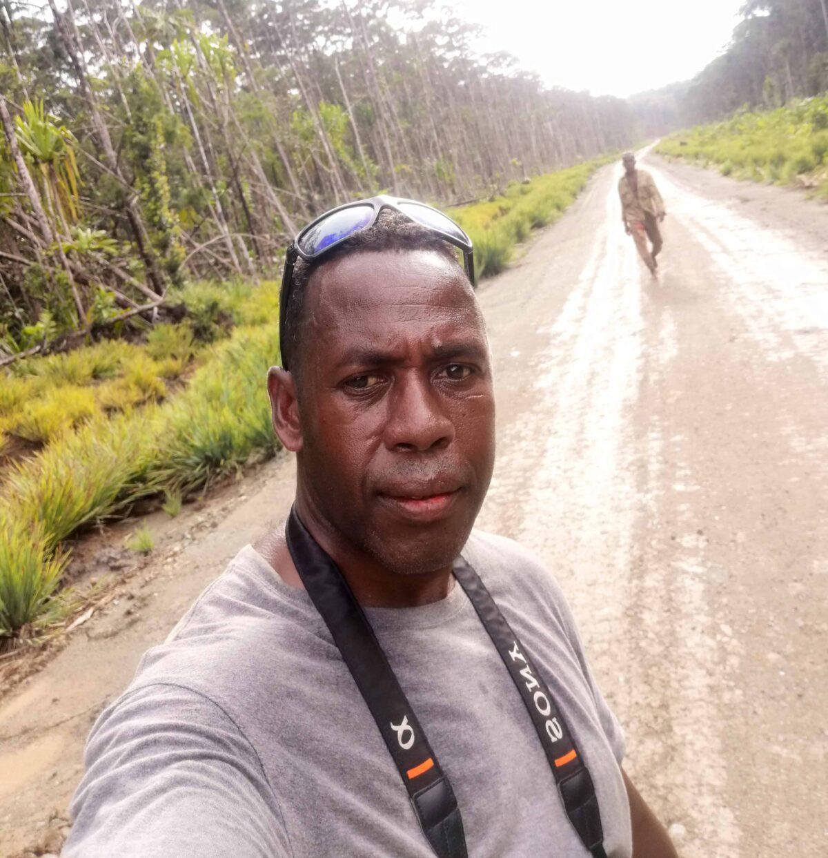 Selfie: a man standing on a dirt road.