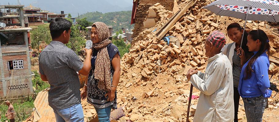 3-Nepal-Deepak interviewing EQ affected .jpg