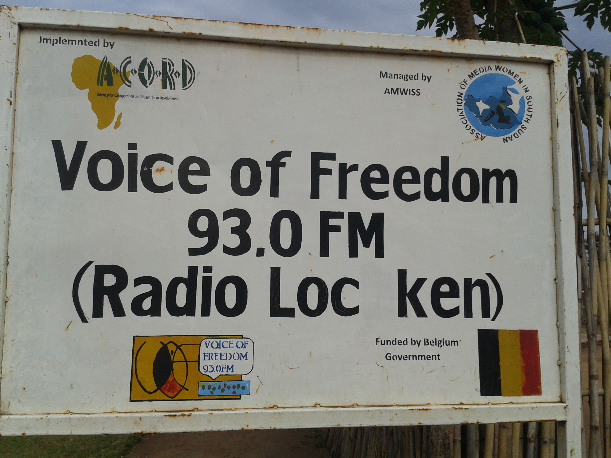 "Sign in front of the radio station says, ""Voice of Freedom FM"""