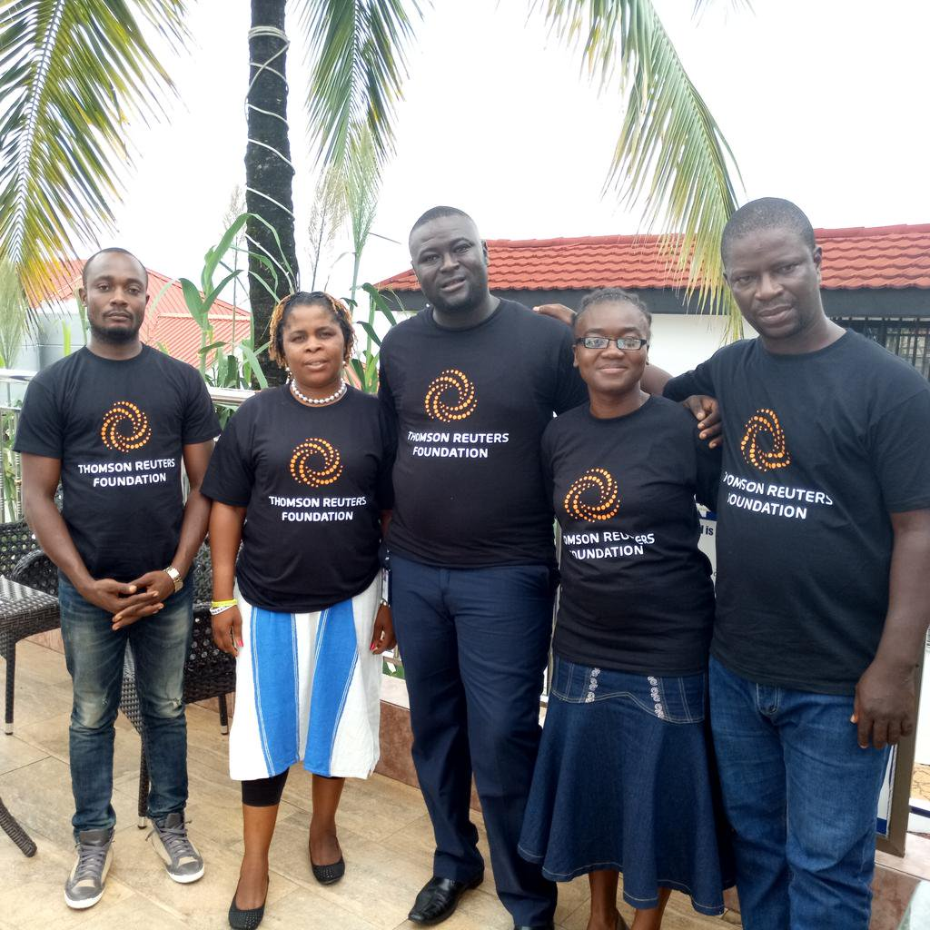 Five reporters stand together, all wearing t-shirts that say Thomson Reuters Foundation