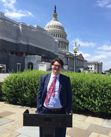 Jared Page standing with Capitol building behind him