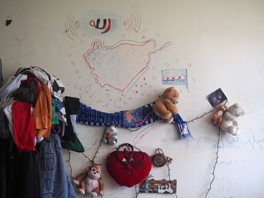 Stuffed animals are attached to a wall