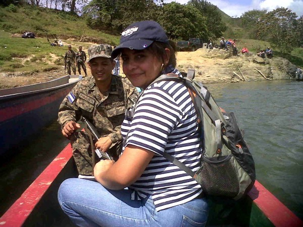 Xiomara sits in a boat with a man