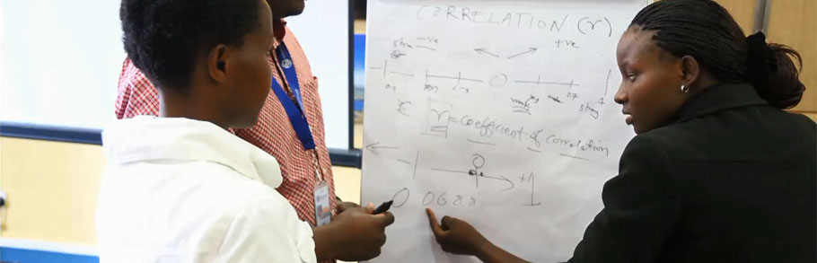 Journalists write on a white board at a training