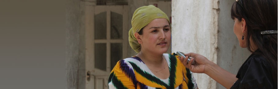 A reporter interviews a Tajik woman