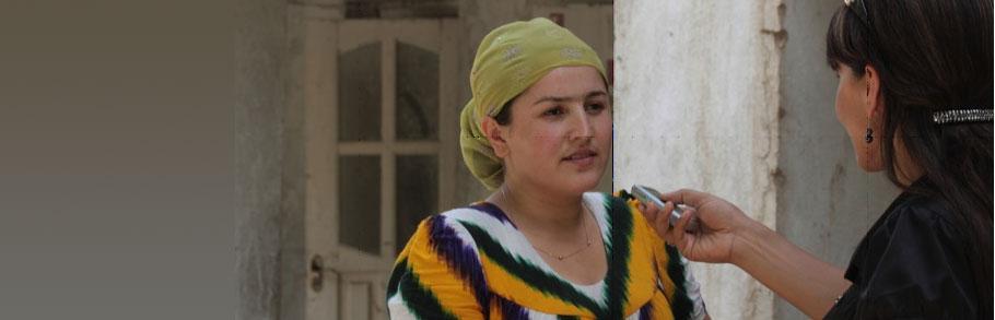 A reporter interviews a Tajik woman