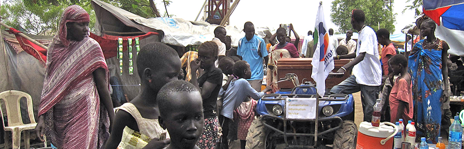 People in a IDP camp in South Sudan gather around the Boda Boda Talk Talk vehicle