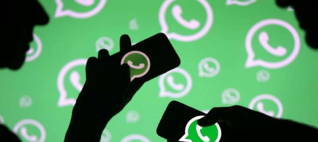 Graphic of two hands holding phones using WhatsApp