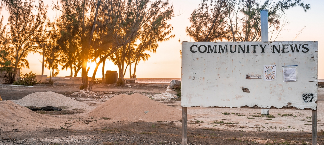 "A sign in a deserted area says, ""Community news"""