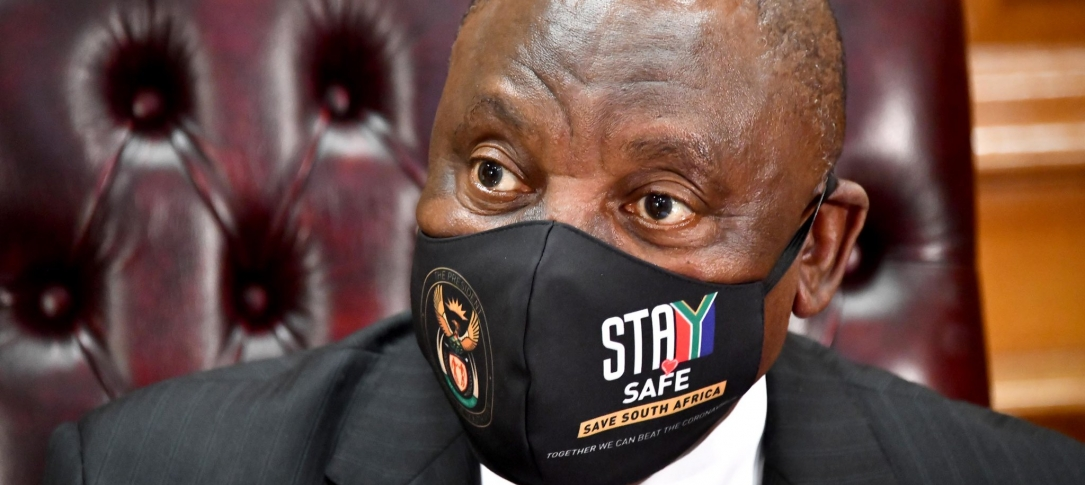 "A man with a mask saying ""Stay Safe - Save South Africa"""