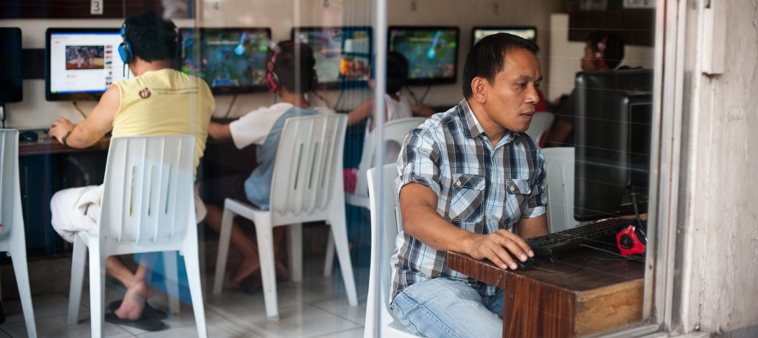 People sit in an Internet cafe