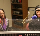 Two women sit in a radio studio