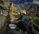 A woman cleaning utensils in Upper Mustang.