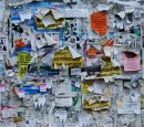 Paper notices tacked on to a message board in Ukraine
