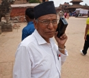 A man in Nepal listens to a portable radio