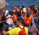 Refugees in a boat approaching the island of Lesvos