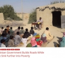 "A group of school children sit on the ground outside a mud hut. A teacher sits at a desk in front of them. Text on the photo says, ""Balochistan government builds roads while people sink further into poverty."