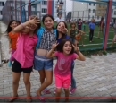 Screenshot from video: a group of children goof around at a playground