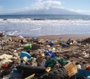 plastic debris is piled up on an ocean beach