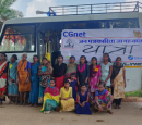 A group of women stand next to a van with a CGNet banner on it.