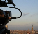 A video camera films a city